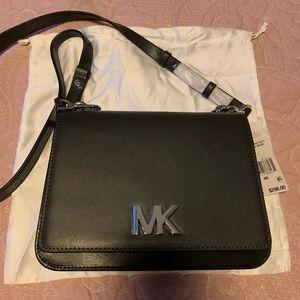 Michael Kors Mott large chain swag leather bag.